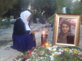 Her mother at Reyhaneh's grave on what would have been her 27th birthday in November