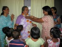 "Sister Lucy Kurien with members of ""her family"""